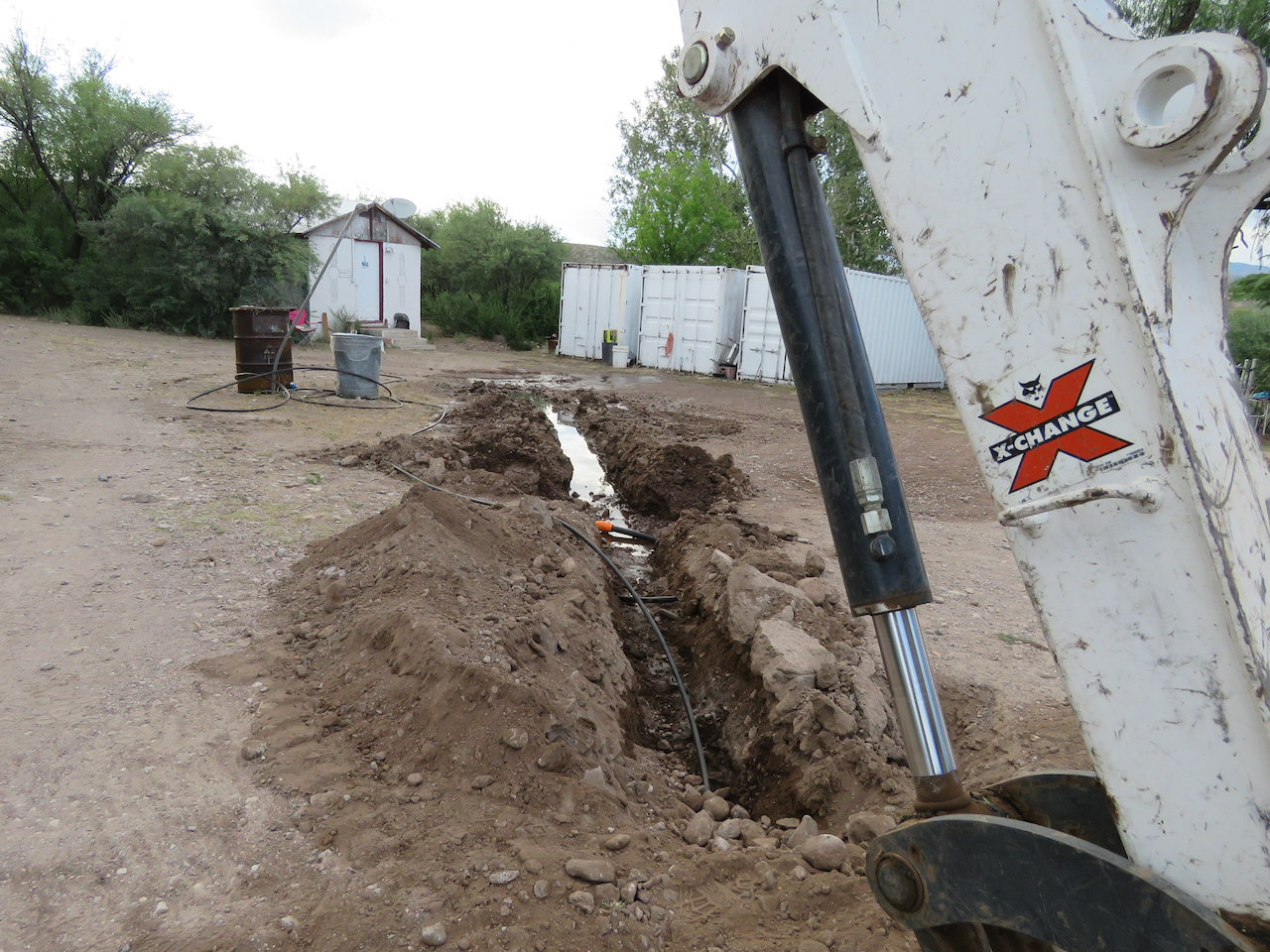 Bobcat cutting fiber optic cable ditch hits water supply